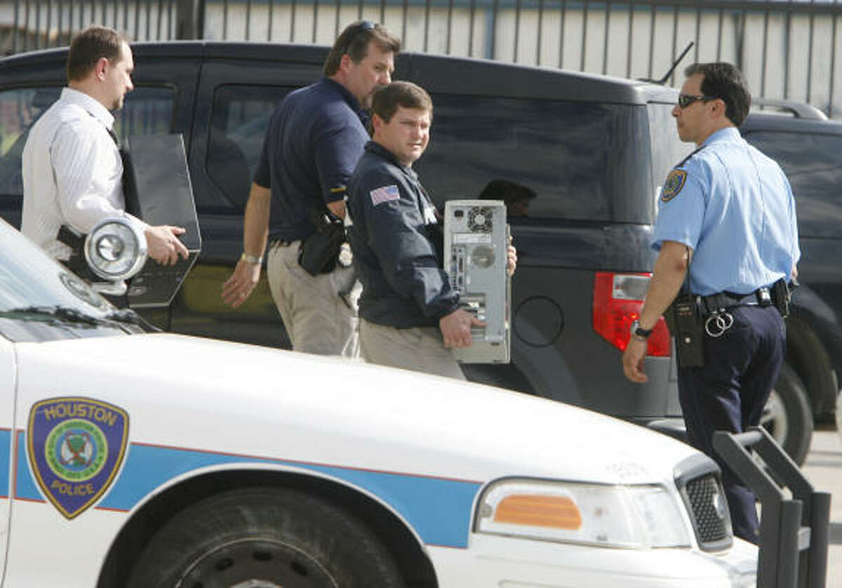 Officials take into custody two computers as officials served federal case warrants at the Nationwide Import Car Salvage store in the northside on Thursday.