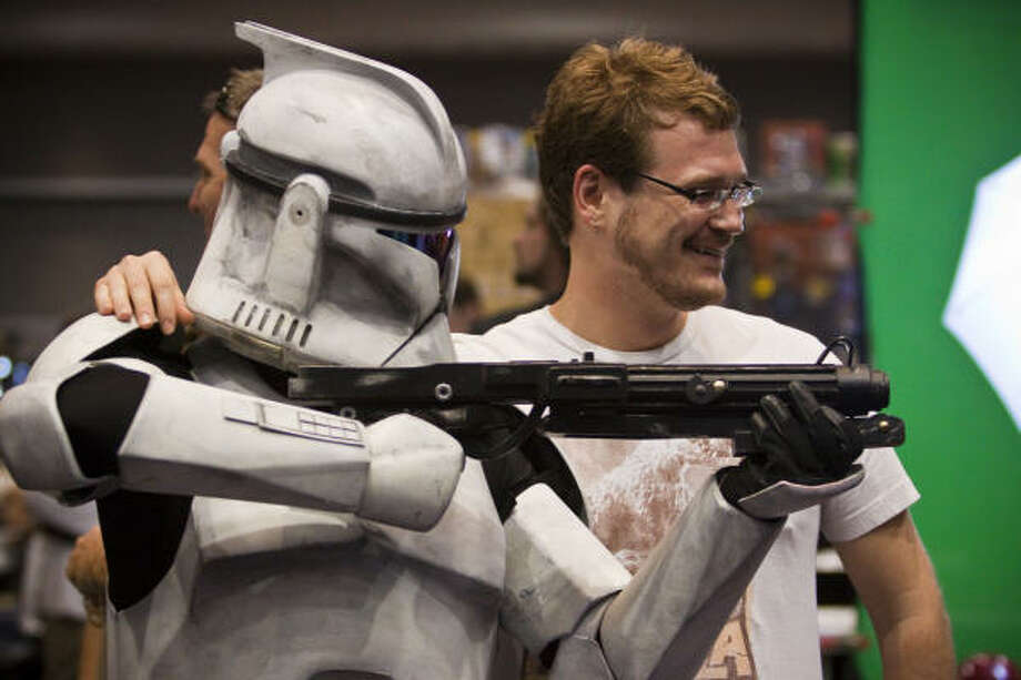 Austin Rea gets his picture made with clone trooper Stephen Bellard, who spent 200 hours making his costume. Photo: Eric Kayne, Chronicle