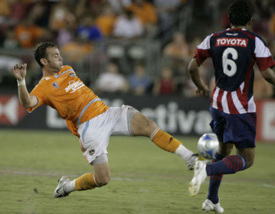 Brad Davis, left, will be one of two players representing the Dynamo at the MLS All-Star Game. Photo: Julio Cortez, Chronicle