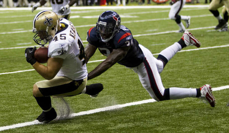 Texans safety Bernard Pollard, right, and the other defensive starters played poorly in Saturday's loss to the Saints. Photo: Brett Coomer, Chronicle