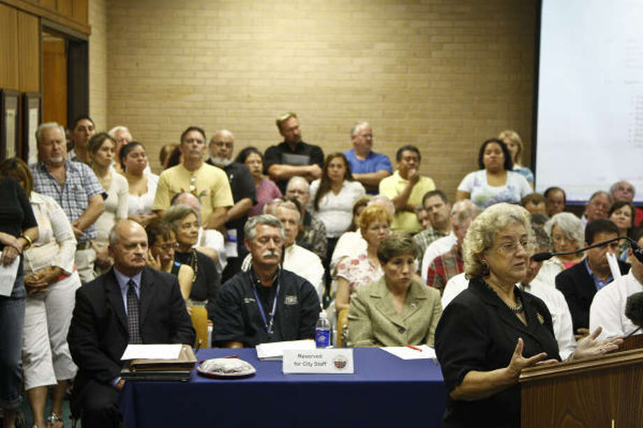 Hirma Jasso makes a statement to the Tomball City Council in favor of the day laborer site during a crowded meeting on Tuesday night. Several matters concerning immigrants were discussed. Photo: Michael Paulsen, Chronicle