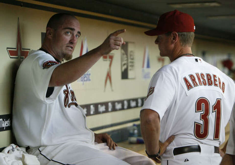 Astros pitcher Brett Myers, left, attributes much of his success this season to pitching coach Brad Arnsberg. Photo: Julio Cortez, Houston Chronicle