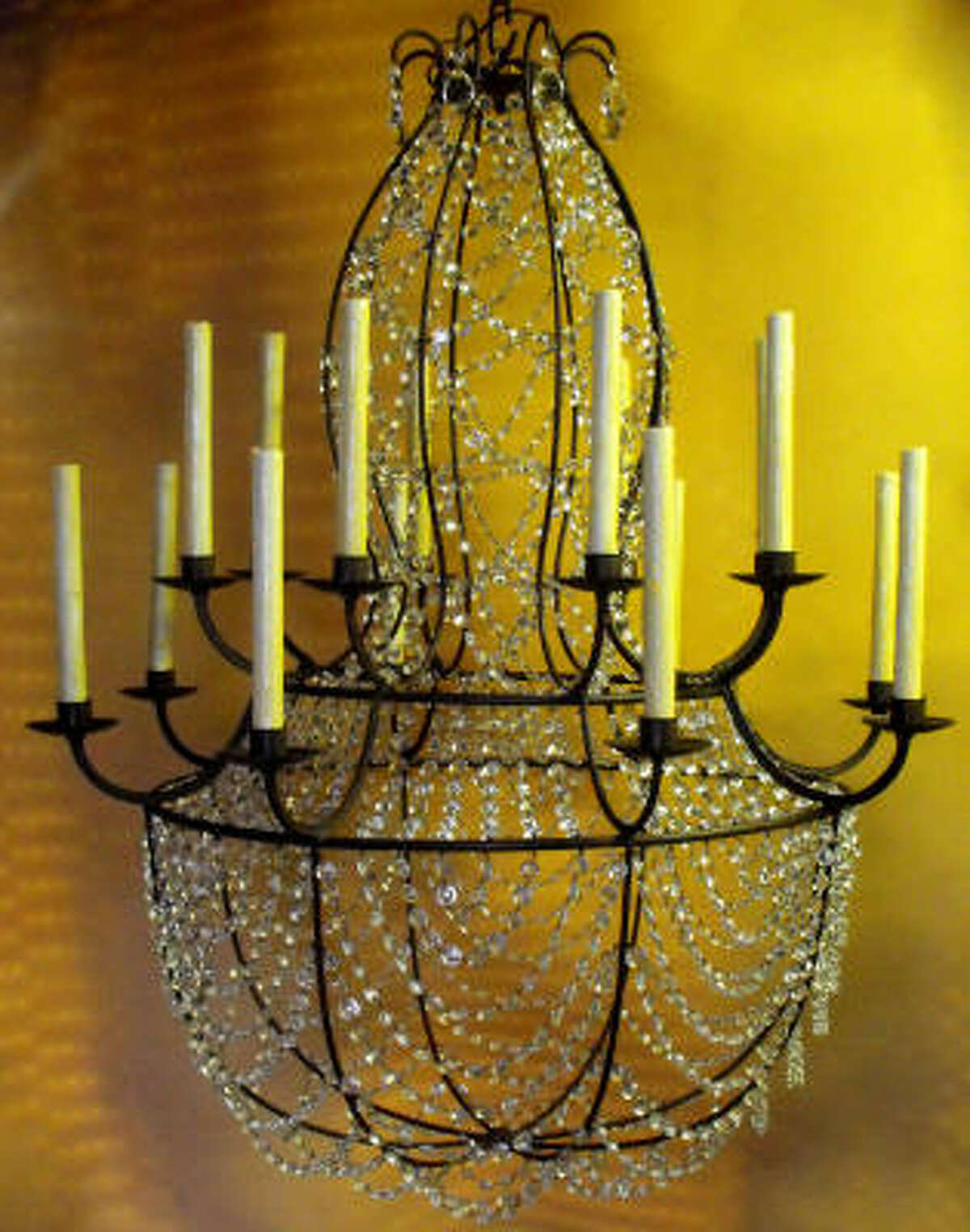 A custom-made chandelier blends an iron frame and crystals. .