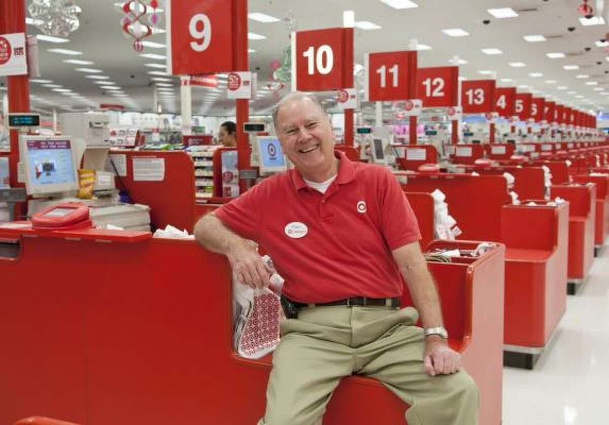 Since he started working at the Friendswood Target three years ago, Robert Tomlinson, 69, has donned a Santa suit each holiday season to meet and greet shoppers at the store.