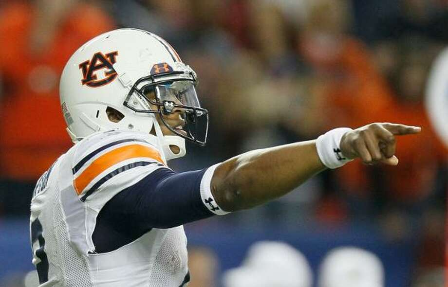 Likely Heisman Trophy winner, Cam Newton leads Auburn into its first BCS title game. Photo: Kevin C. Cox, Getty Images
