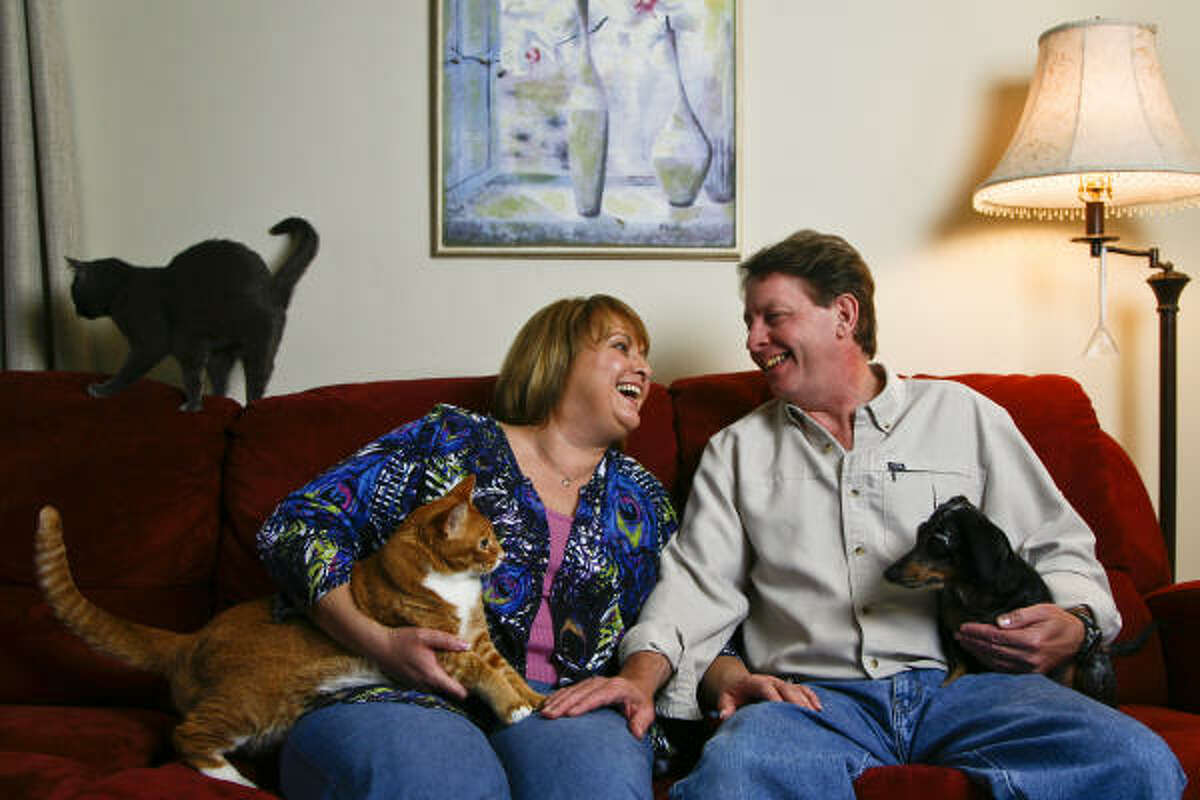 Nancy Wilemski and her soon-to-be husband Steve Kearney, seen here with their pets, Chloe, from left, Jasper, and Abby, The two are planning a March 17 wedding in Fredericksburg.