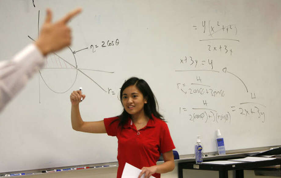 Jennifer Lastimosa, 19, gets a pointer from teacher Anil Desai at Houston's DeBakey High. Photo: Karen Warren, Chronicle