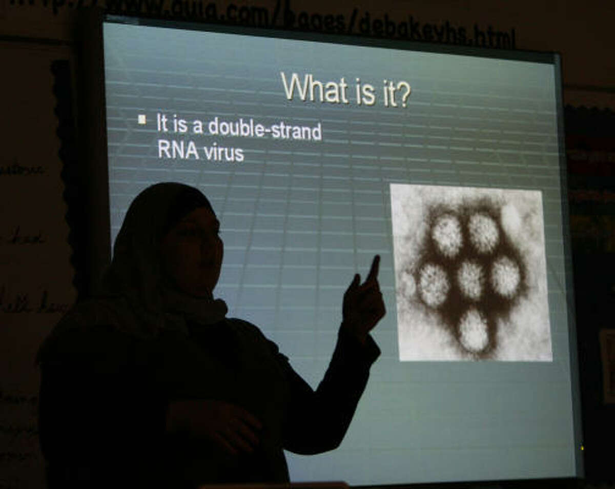 Aiat Radwan, a senior at DeBakey High School for Health Professions, is silhouetted while giving a PowerPoint presentation. The HISD magnet ranked third in Texas and first in the Houston area.