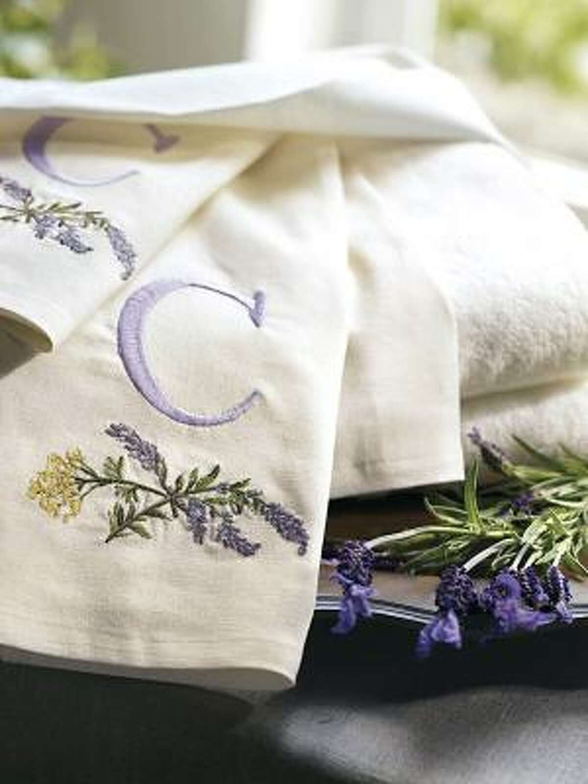 Pottery Barn's lavender embroidered towels have a homey ambience.