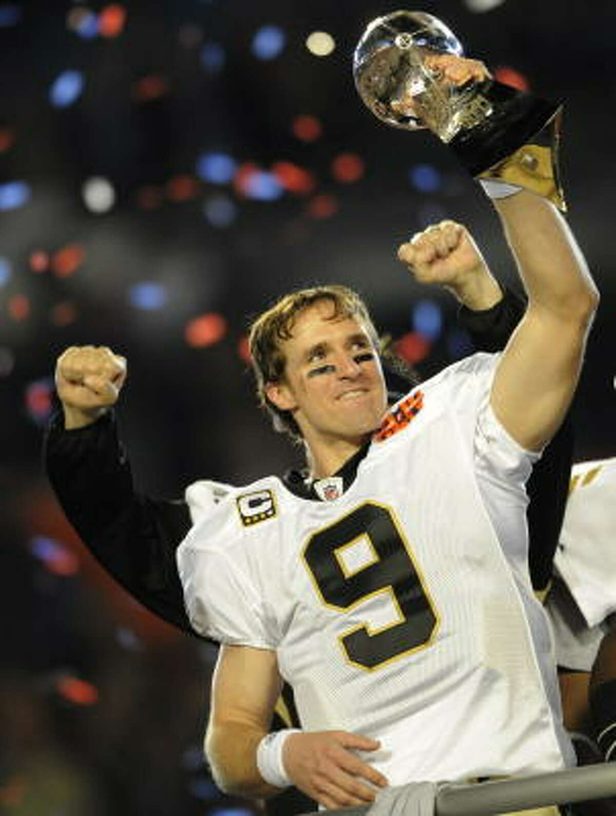 New Orleans Saints quarterback Drew Brees celebrates Sunday after a Super Bowl victory against the Indianapolis Colts.