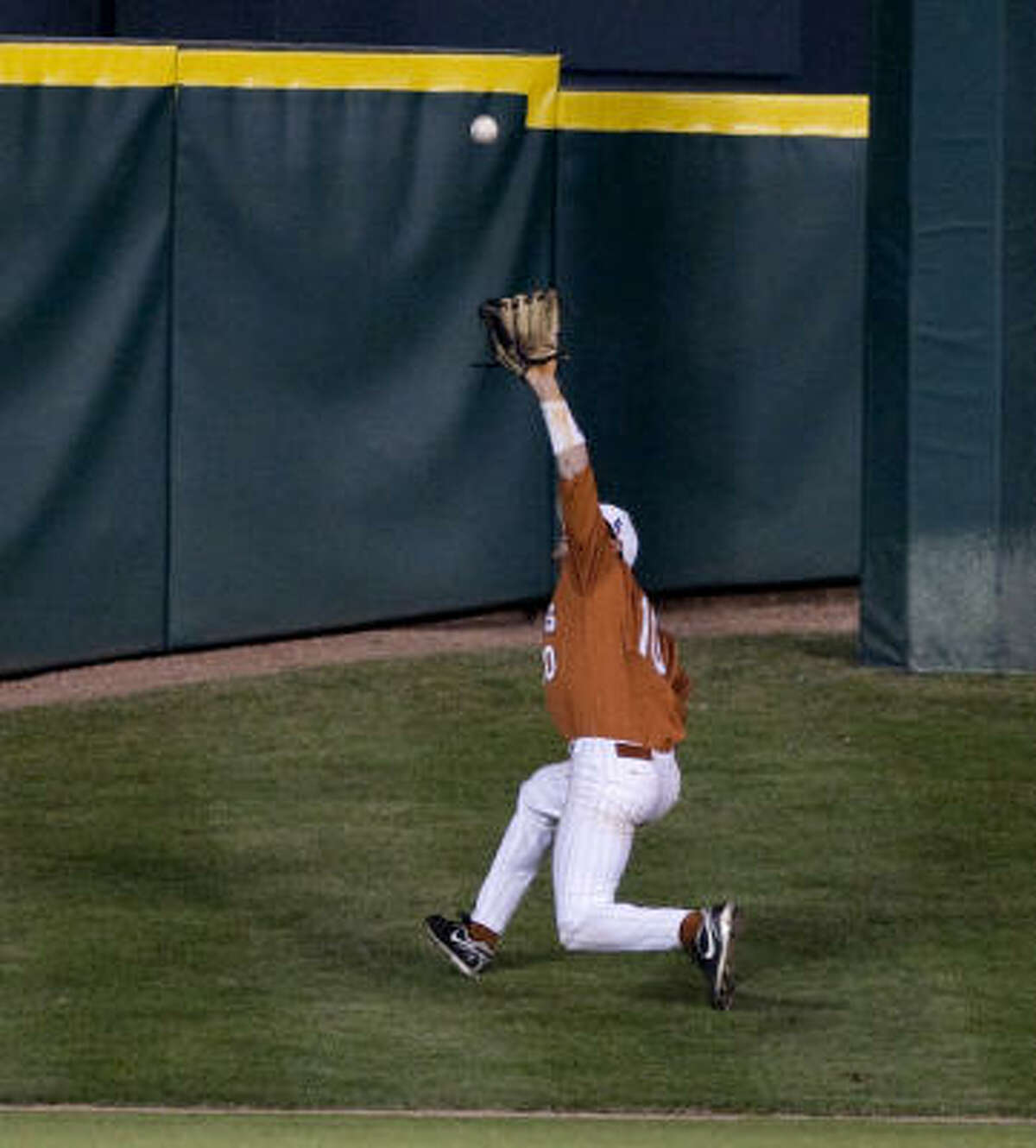 Texas center fielder Connor Rowe runs up Tal's Hill to make the catch on a deep fly ball off the bat of Rice's Chad Mozingo in the eighth inning.