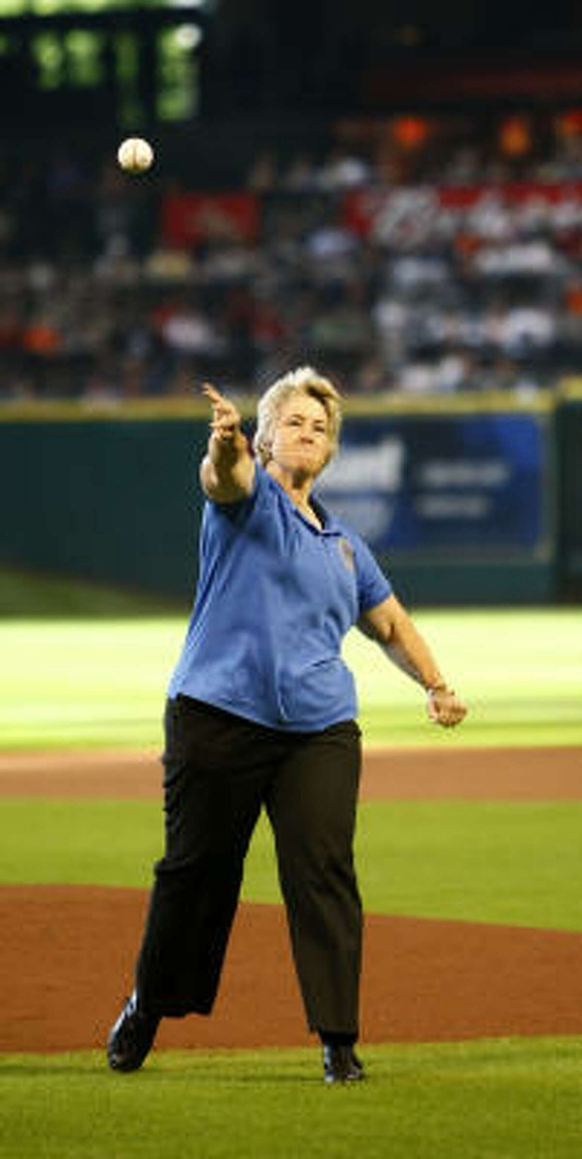 Mayor Annise Parker throws out the ceremonial first pitch.