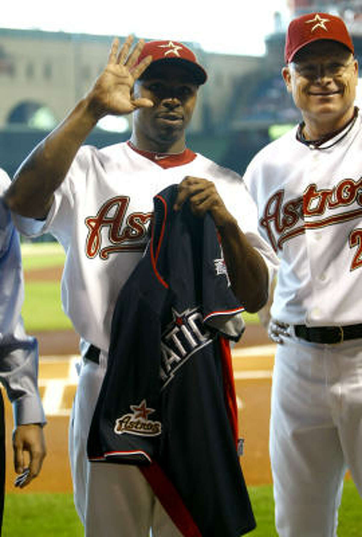 Astros center fielder Michael Bourn receives his All-Star jersey during a pregame ceremony.