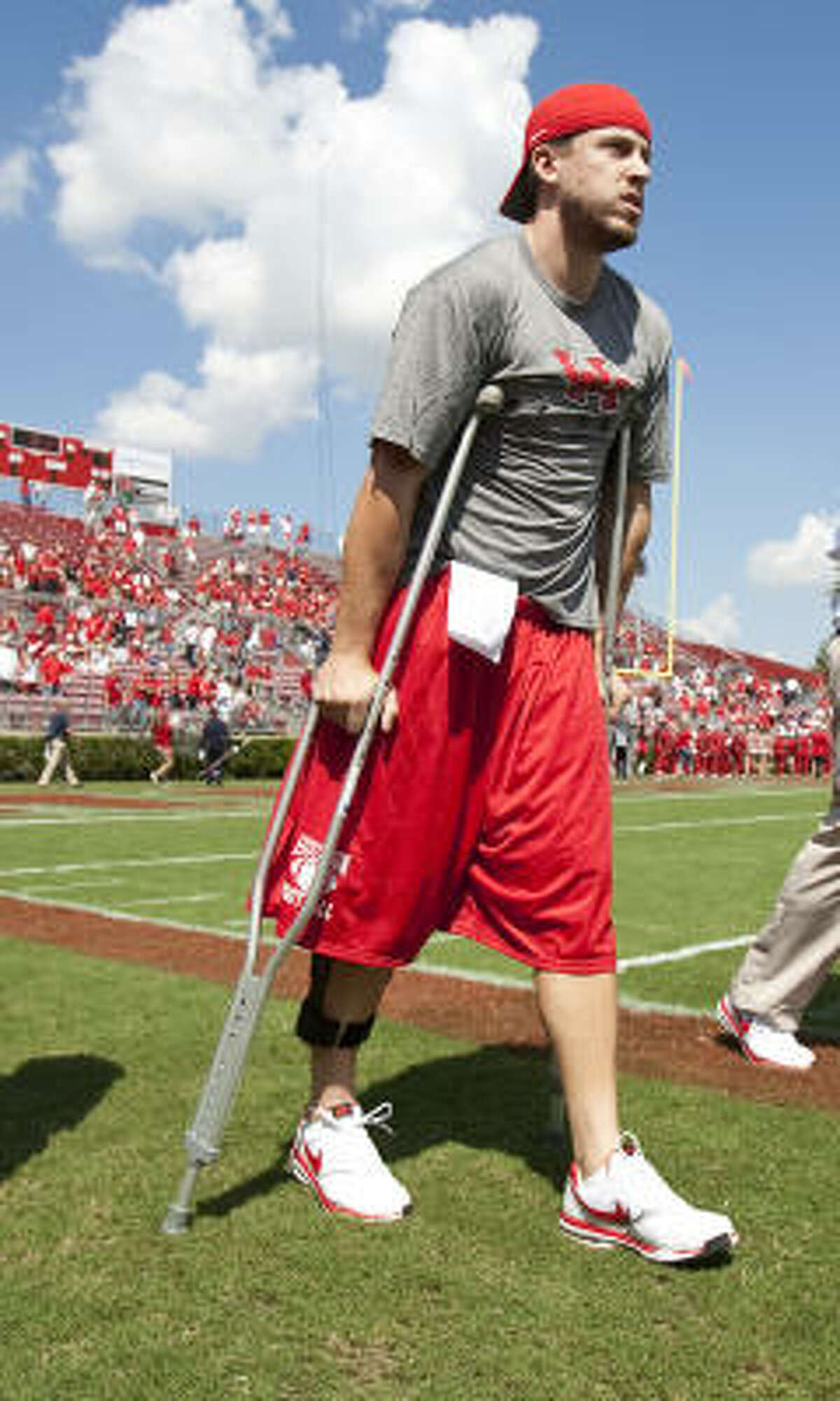 Injured UH quarterback Case Keenum attended the Coogs' win over Tulane last Saturday.