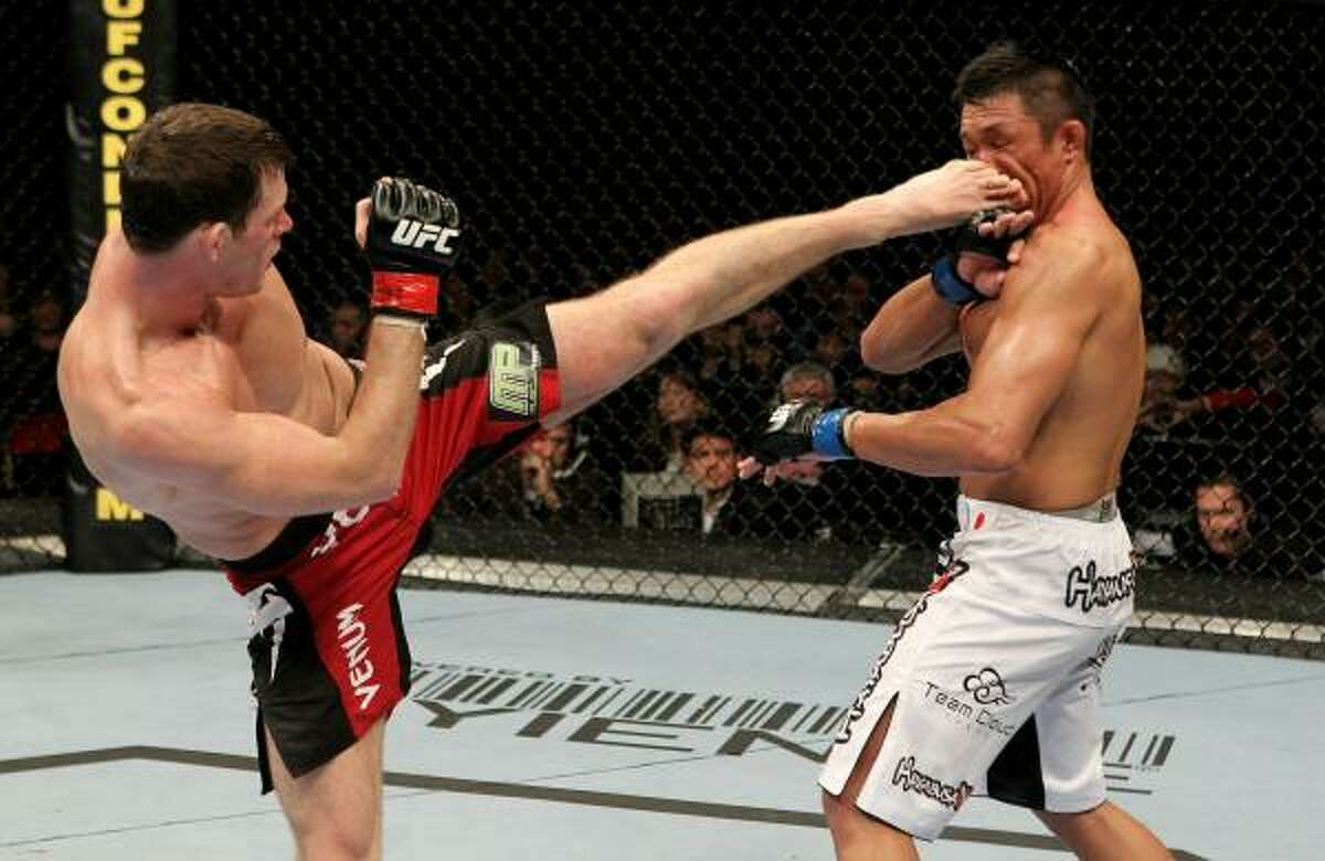 Michael Bisping of Great Britain kicks Yoshihiro Akiyama of Japan in the face during their UFC middleweight bout at the O2 Arena on Saturday in London.