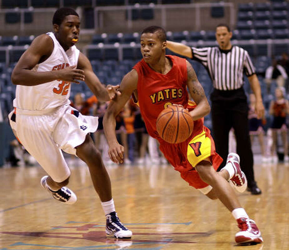 Yates, shown playing against Seven Lakes, set a state scoring record against fellow HISD school Lee.
