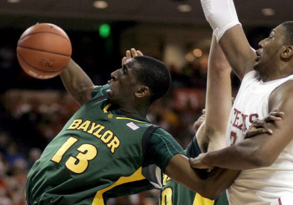 Baylor center Ekpe Udoh, left, grabs a rebound in front of Texas center Dexter Pittman.