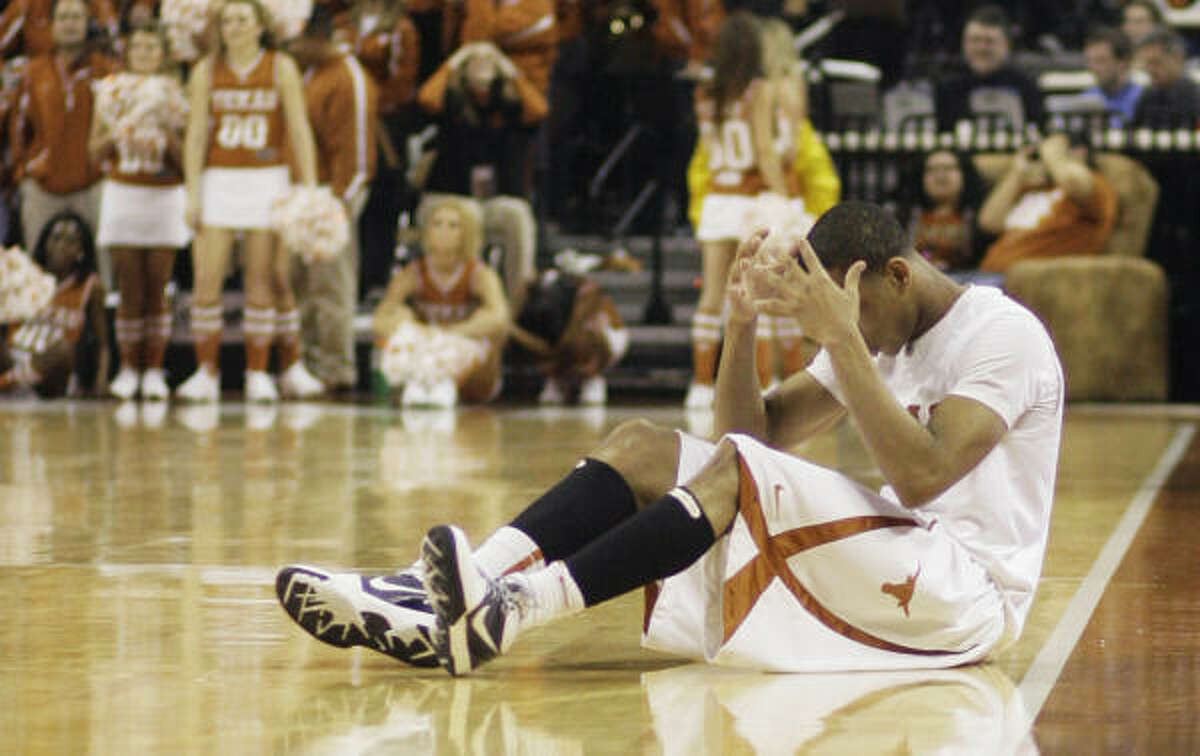 Texas guard Avery Bradley sits on the floor after missing a 3-pointer as time expired in overtime.