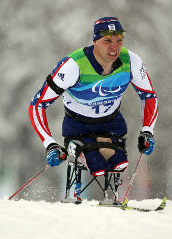 Andy Soule captures the bronze in the 2.4-kilometer pursuit sitting biathlon at the Vancouver Winter Paralympics at Whistler Paralympic Park. Photo: Hannah Johnston, Getty Images