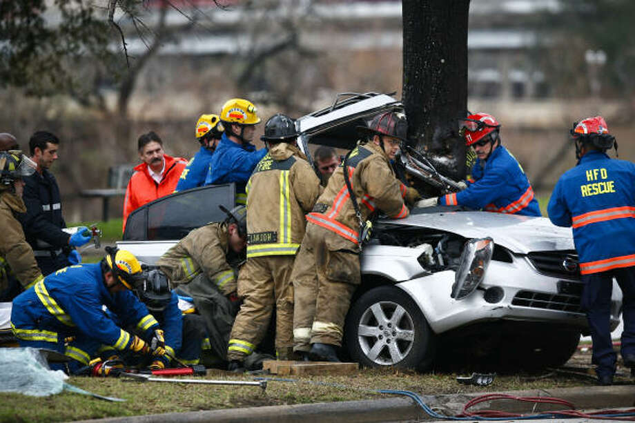 The 19-year-old driver of this Nissan was seriously injured March 1 after his car was hit by a vehicle on Allen Parkway. The victim lost control and hit a tree. The driver of the other car did not stop and has not been caught. Photo: Michael Paulsen, Chronicle