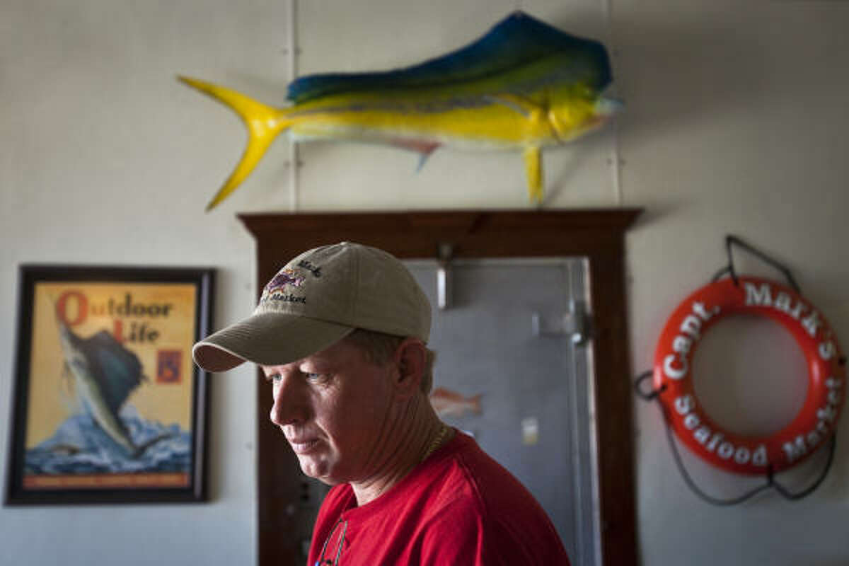 Mark Friudenberg has adjusted to a slowing of demand by buying less fish for his wholesale and retail businesses. That means fishermen have been forced to reduce their catches.