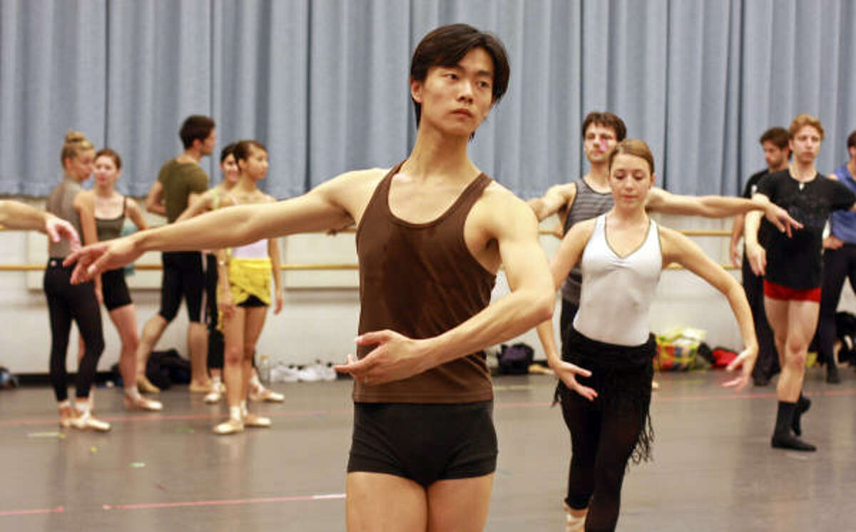 Huang's graceful lines and powerful classical technique are evident even in company class.