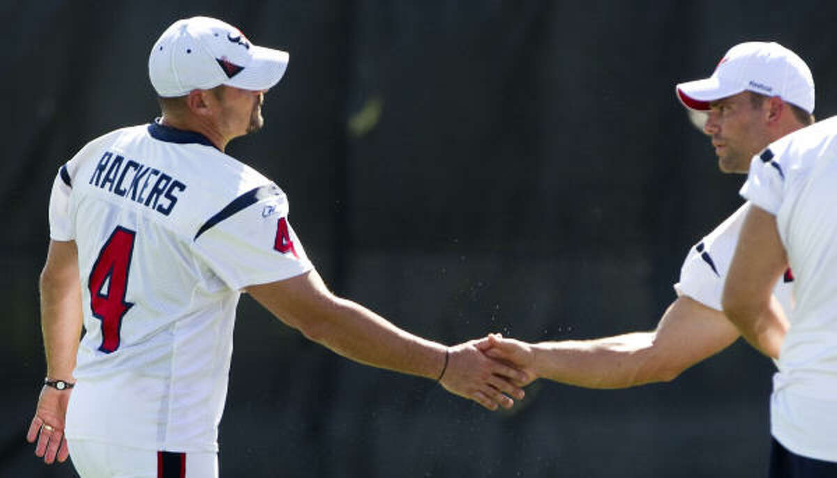 Neil Rackers (4) and Kris Brown await Friday's decision regarding which kicker the Texans will keep.