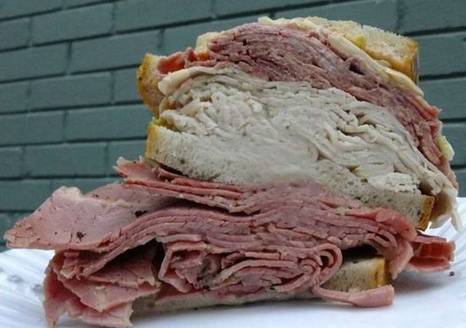 "Kenny & Ziggy's ""Tongues of Fun"" sandwich is loaded with tongue, turkey, corned beef ans slaw Photo: ALISON COOK :, CHRONICLE"