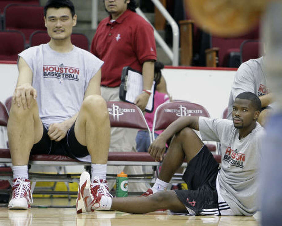 Aaron Brooks, right, said his approach won't change despite a contract that has him making far less than his backup, Kyle Lowry, this season. Photo: James Nielsen, Houston Chronicle