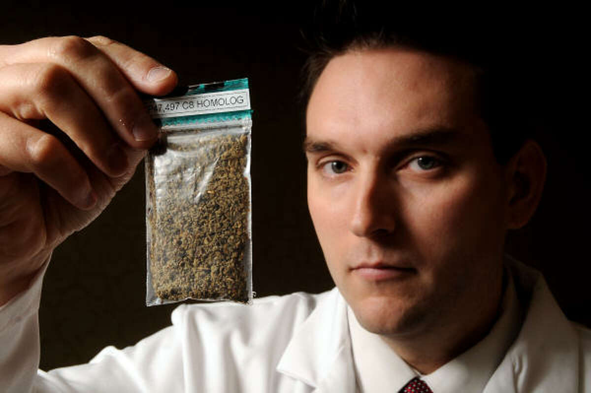 Mark Dixon, of the Harris County Institute of Forensic Sciences, examines a synthetic marijuana substitute that has been blamed for violent, frightening reactions after being smoked.
