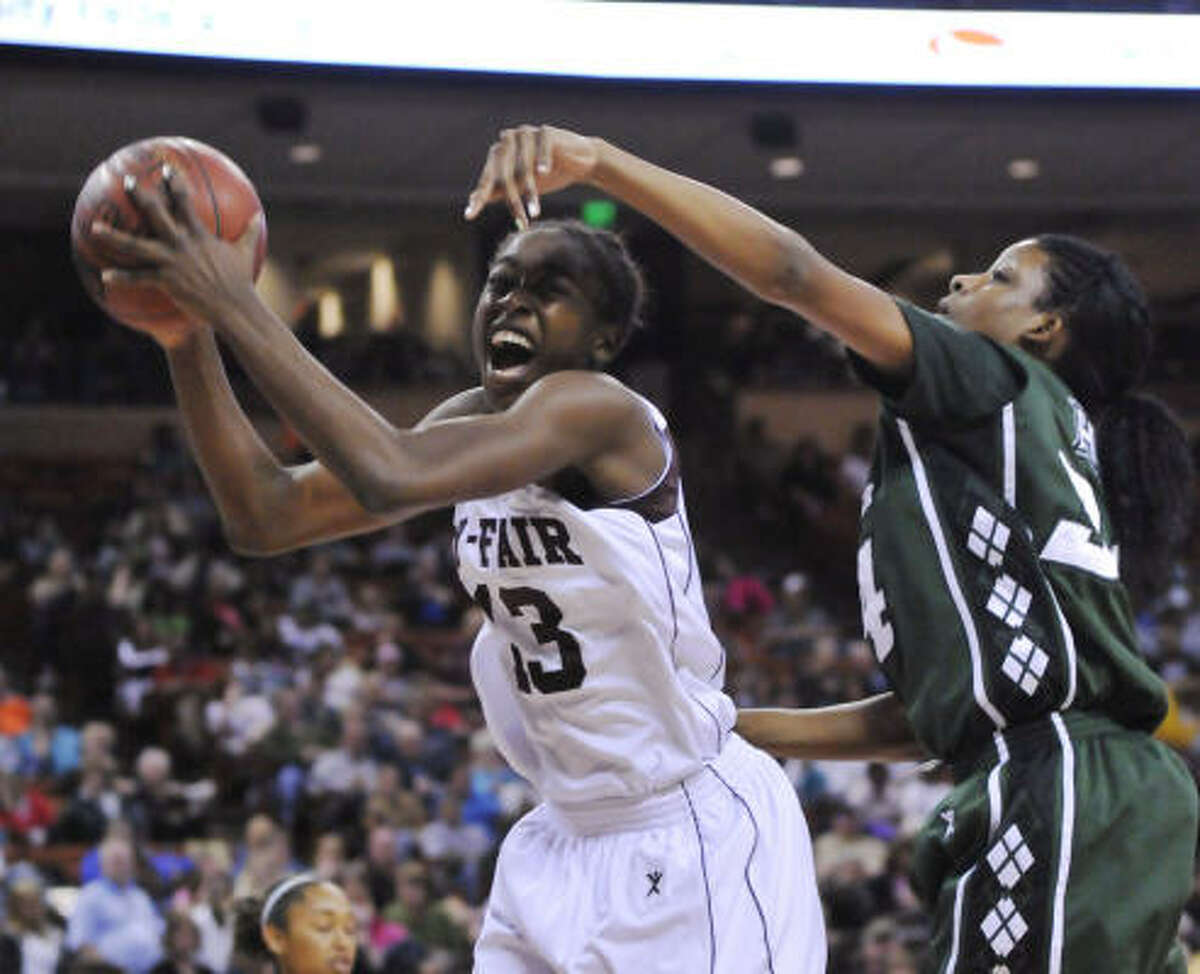 Cy-Fair's Chiney Ogwumike pulls one of her 18 rebounds away from Hightower's Taylor Gilbert in the championship game.