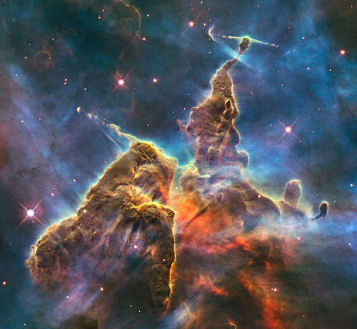 This composite image from the Hubble telescope, taken between Feb. 1 and 2, shows an image of a pillar of star birth, three light-years high. The image celebrates the 20th anniversary of Hubble's launch.