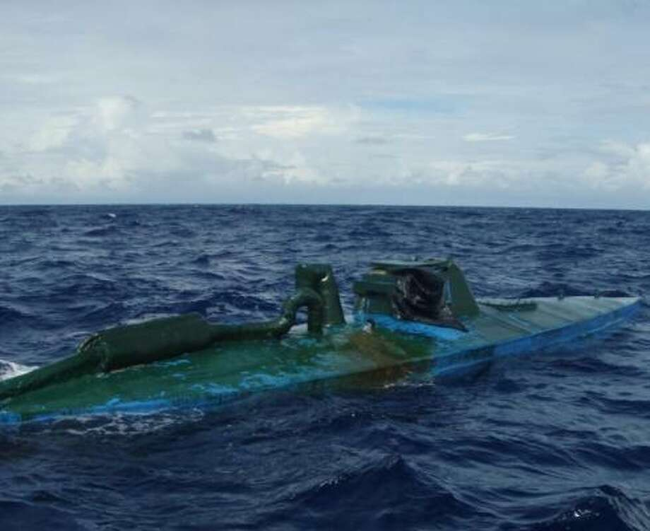 "A U.S. Coast Guard cutter, guided by aircraft from Customs and Border Protection, captured this so-called ""narco sub"" - packed with cocaine - off the coast of Colombia last month. Photo: Coast Guard"