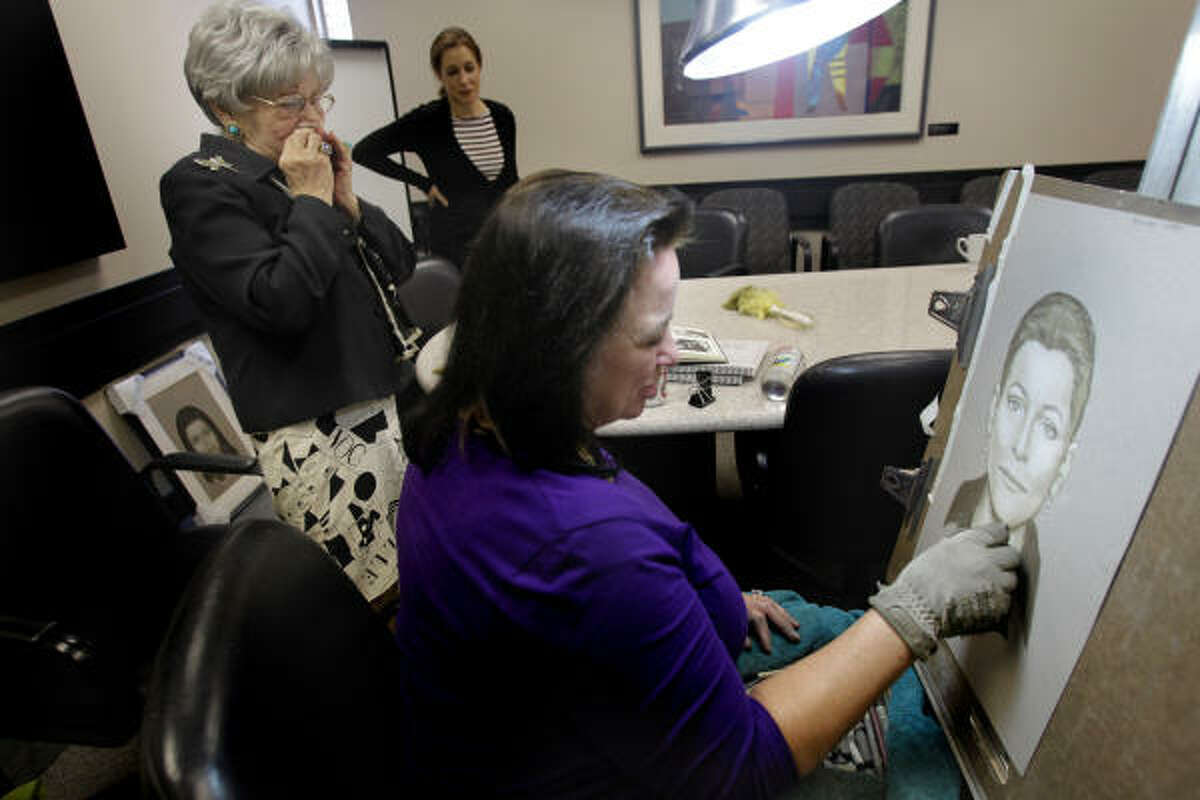 Holocaust survivor Helen Colin, left, weeps as she sees her mother's portrait finalized by Lois Gibson,a forensic artist at the Holocaust Museum.