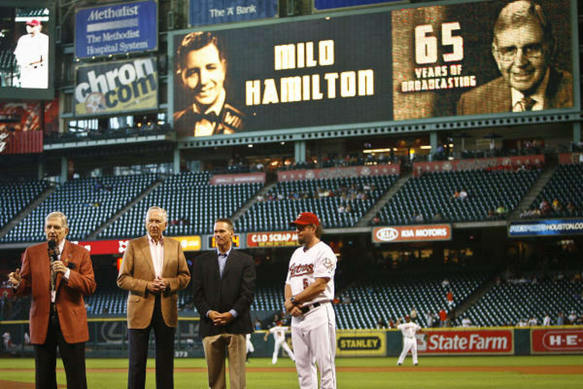 The Astros recognize Milo Hamilton, left, for 65 years of broadcasting and his upcoming 83rd birthday.