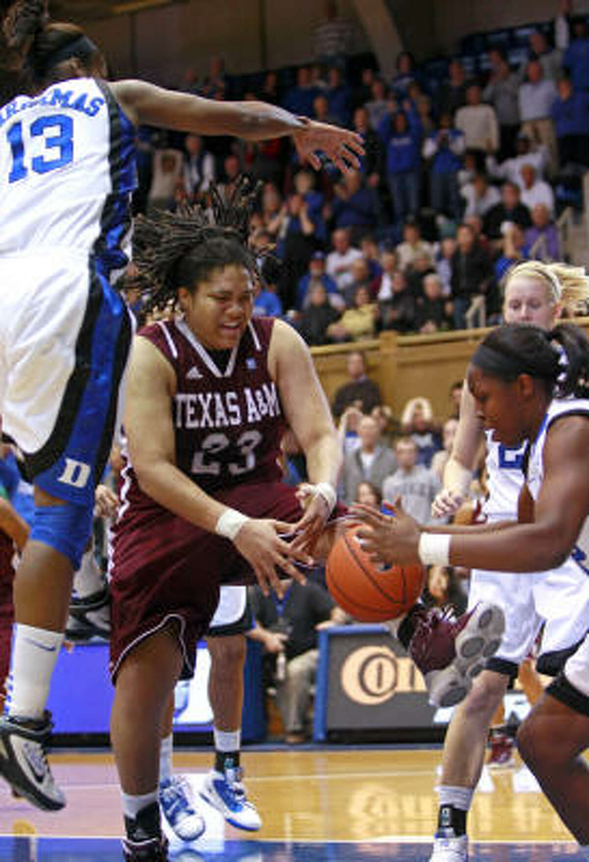 Duke's Karima Christmas (13) and Chelsea Gray, right, battle with Texas A&M's Danielle Adams (23) during the second half on Monday night.