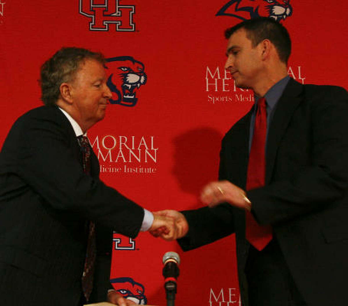 Since Tom Penders' resignation, athletic director Mack Rhoades, right, has been weighing all the possible options for the coaching vacancy.