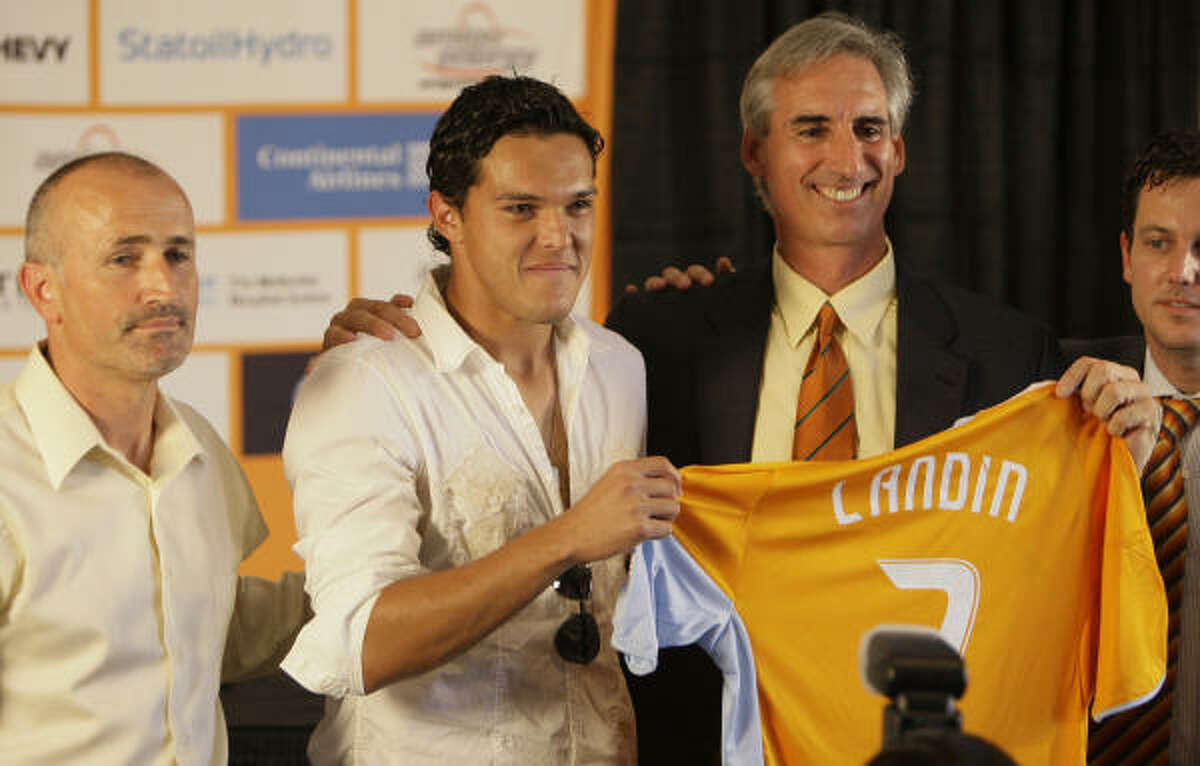 Dynamo president Oliver Luck, right, has forged a relationship with Ed Emmett as they work to promote soccer.