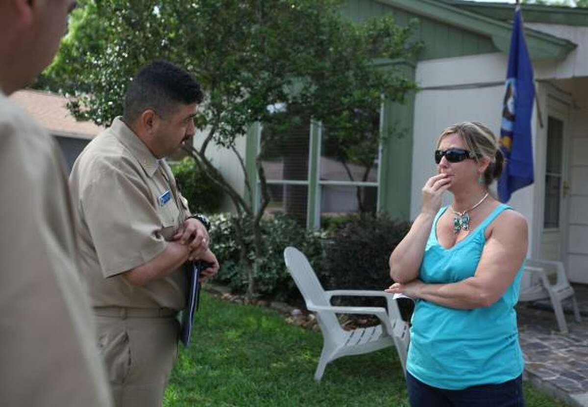 ARRANGEMENTS: Krista Hamilton, sister of Zarian Wood, talks with Navy personnel about the funeral for her brother.