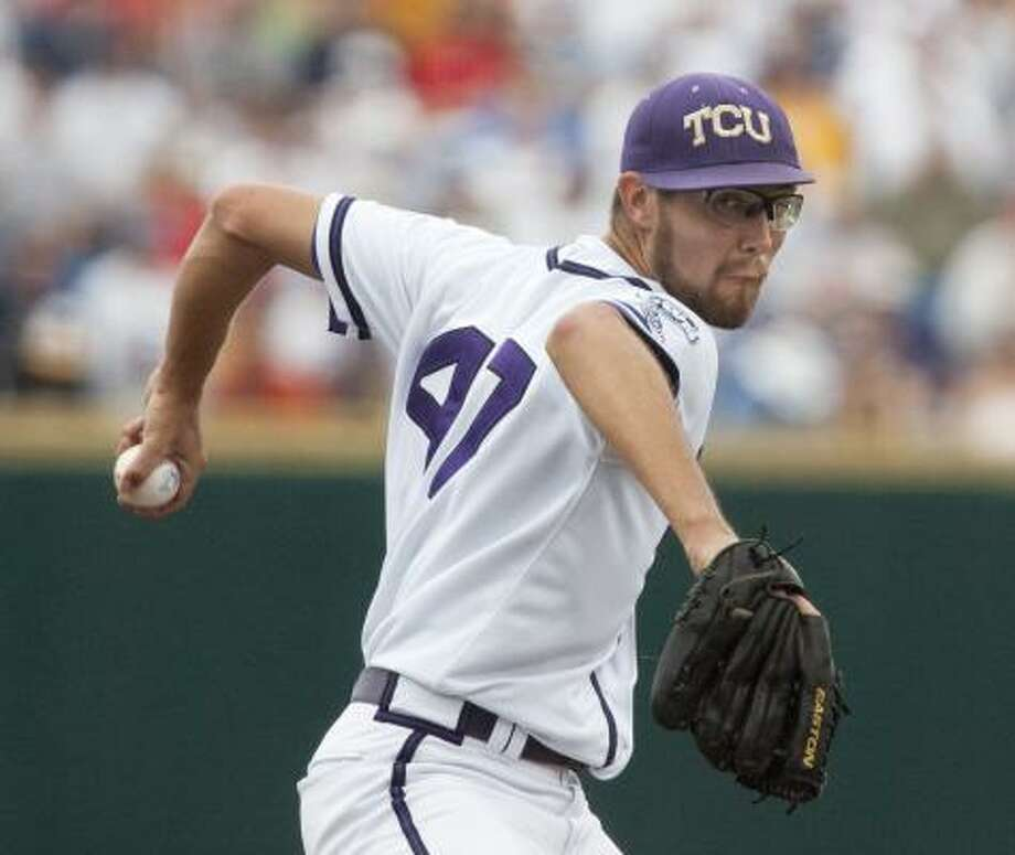Klein product Matt Purke pitched TCU to its first-ever CWS win, relying on help from catcher Bryan Holaday. Photo: Nati Harnik, AP