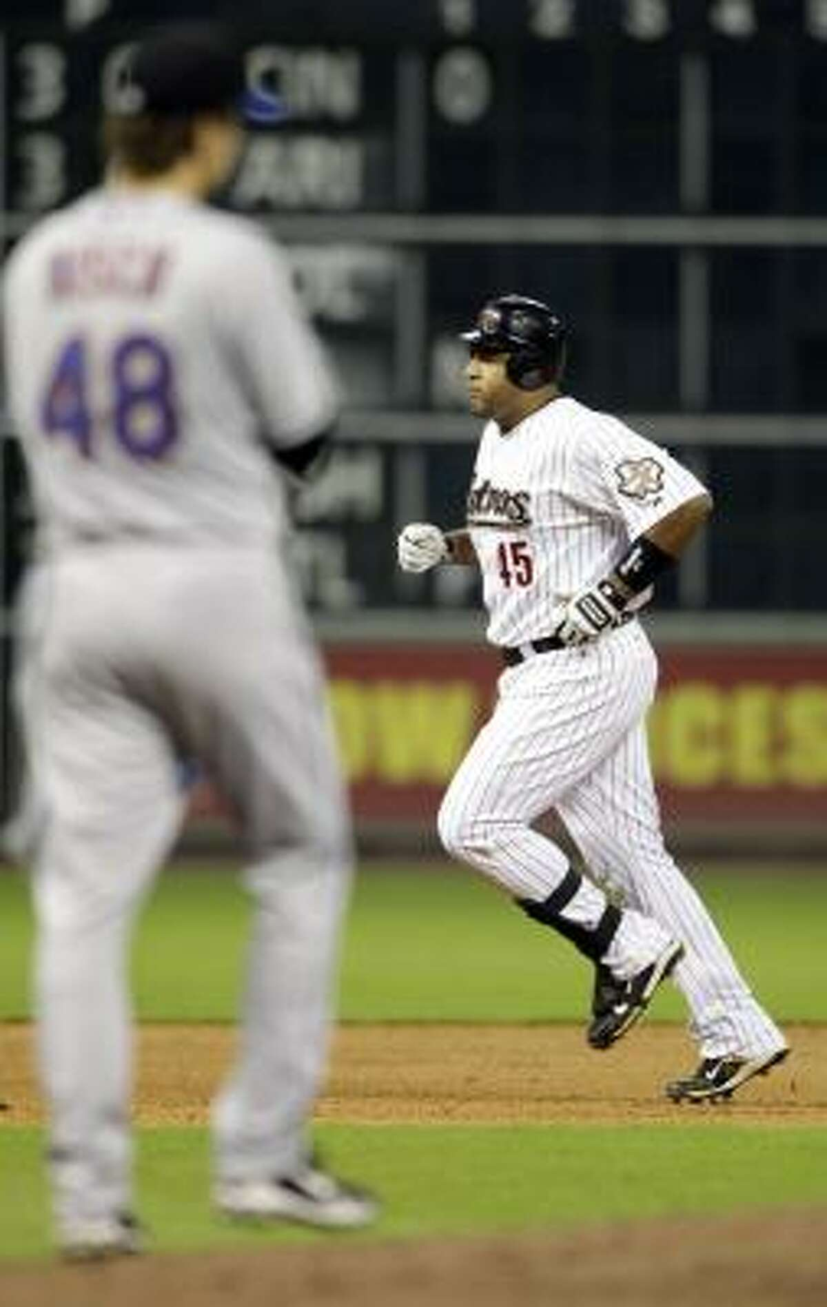 Carlos Lee rounds the bases after hitting a three-run home run during the seventh inning.