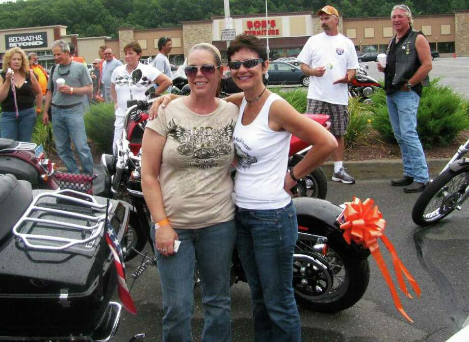 Left, Pam Lind, of New Canaan, and Karen Butler, of Manchester, pose at the start of the 2011 MS Motorcycle Ride, Sunday, July 24, at the Outback Steakhouse in Southington. Photo: Contributed Photo