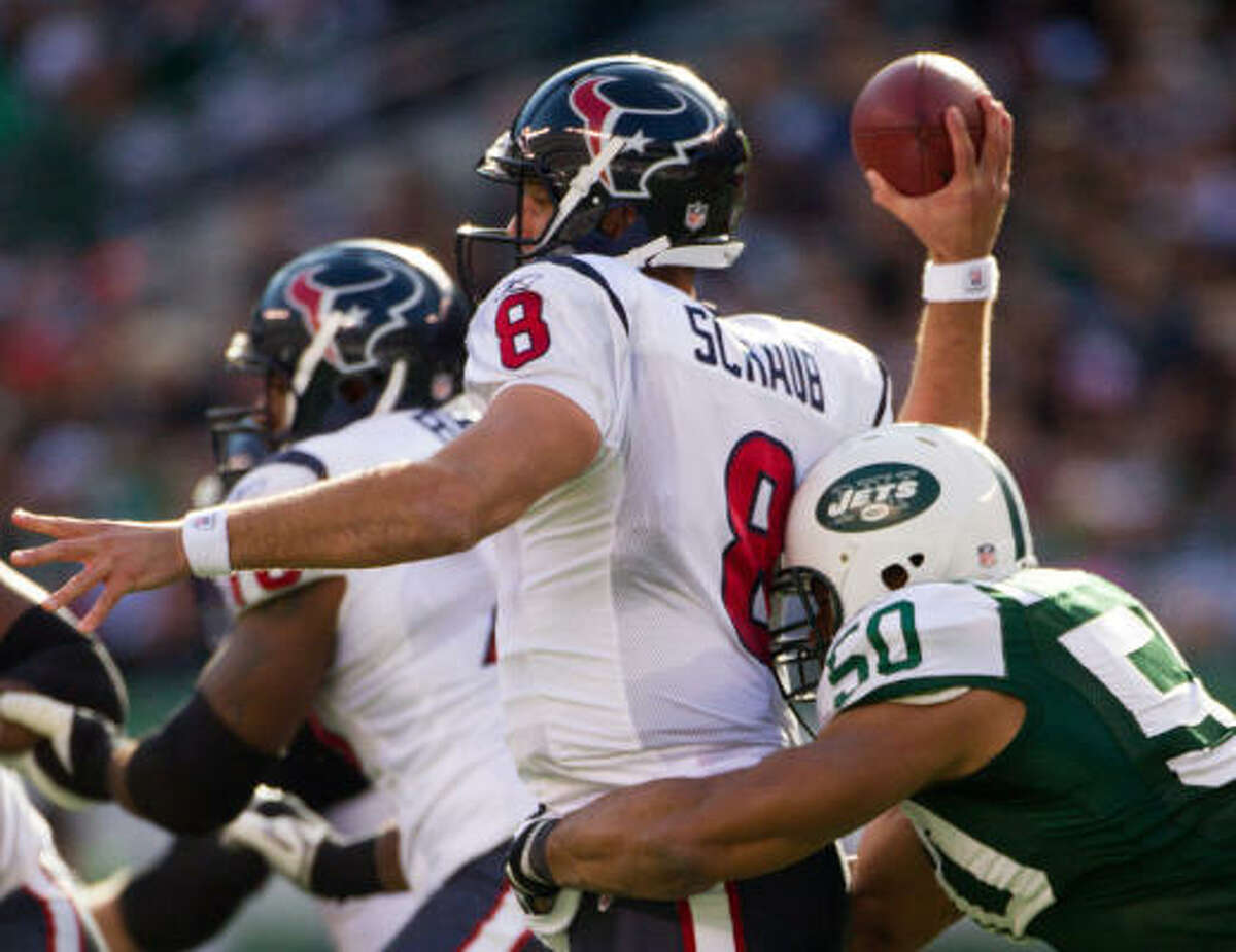 Jets defensive end Vernon Gholston hits Texans quarterback Matt Schaub in the back as he delivers a pass.
