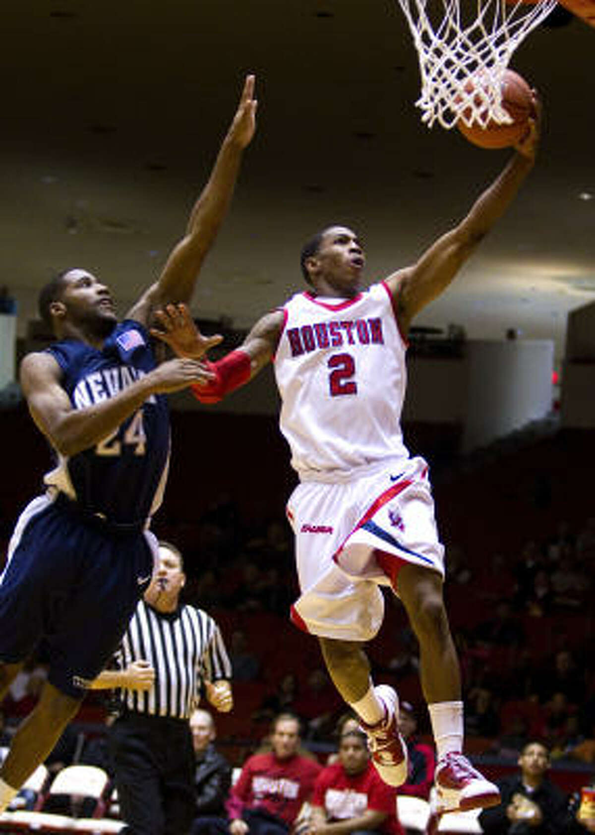 UH guard Zamal Nixon, right, looks to lay the ball in the basket during Monday night's win.
