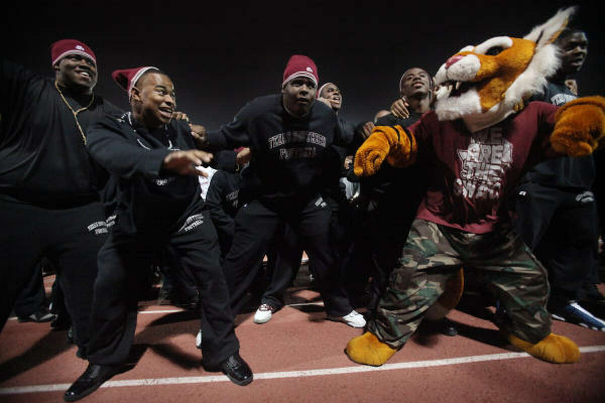 Marvin Hollie, Eoles Whitaker, Kenny Hall, and Rex the Tiger show their swag during a pep rally leading up to Saturday's big game.