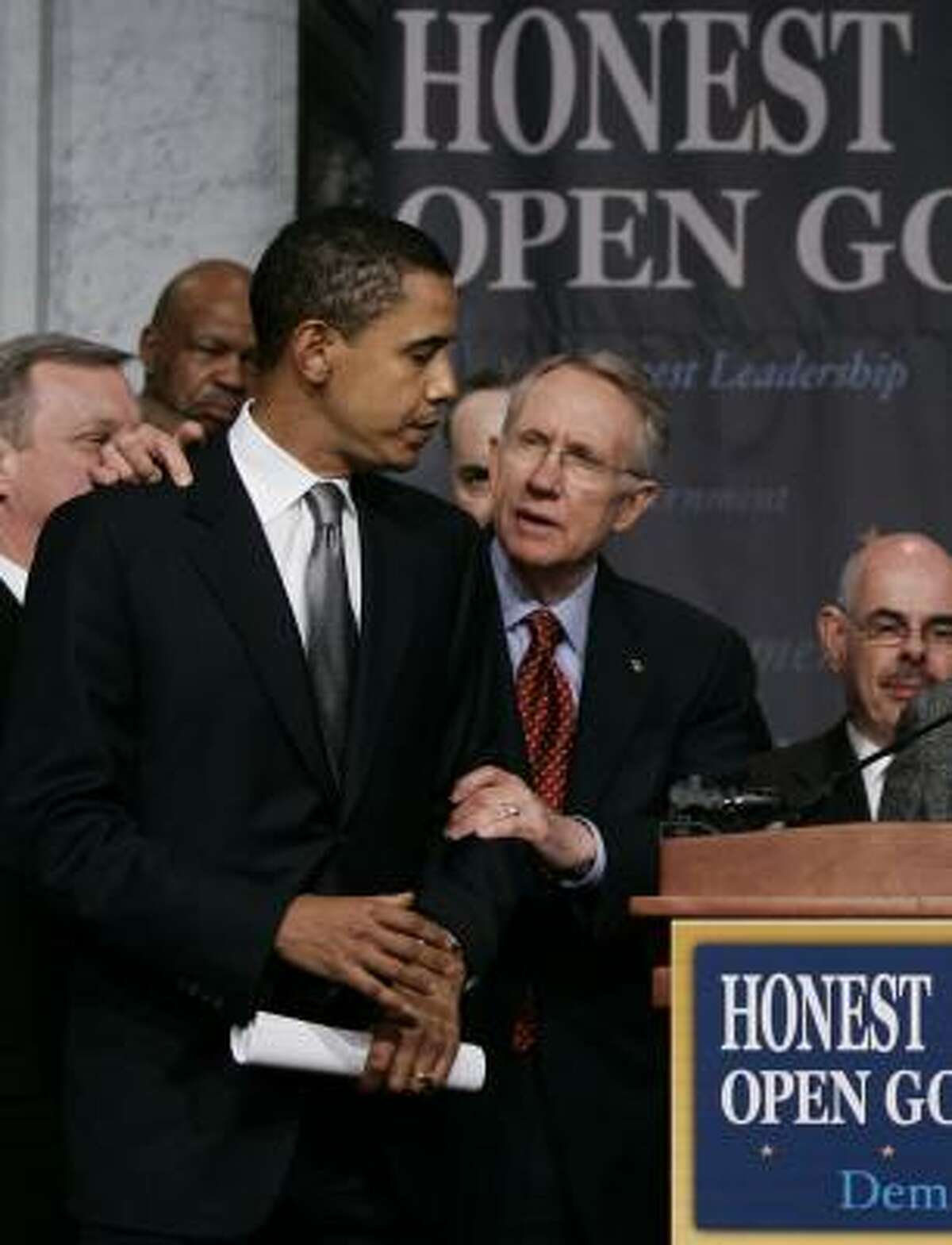Senate Democratic Leader Harry Reid, shown with then-Sen. Barack Obama in 2006, apologized on Saturday for