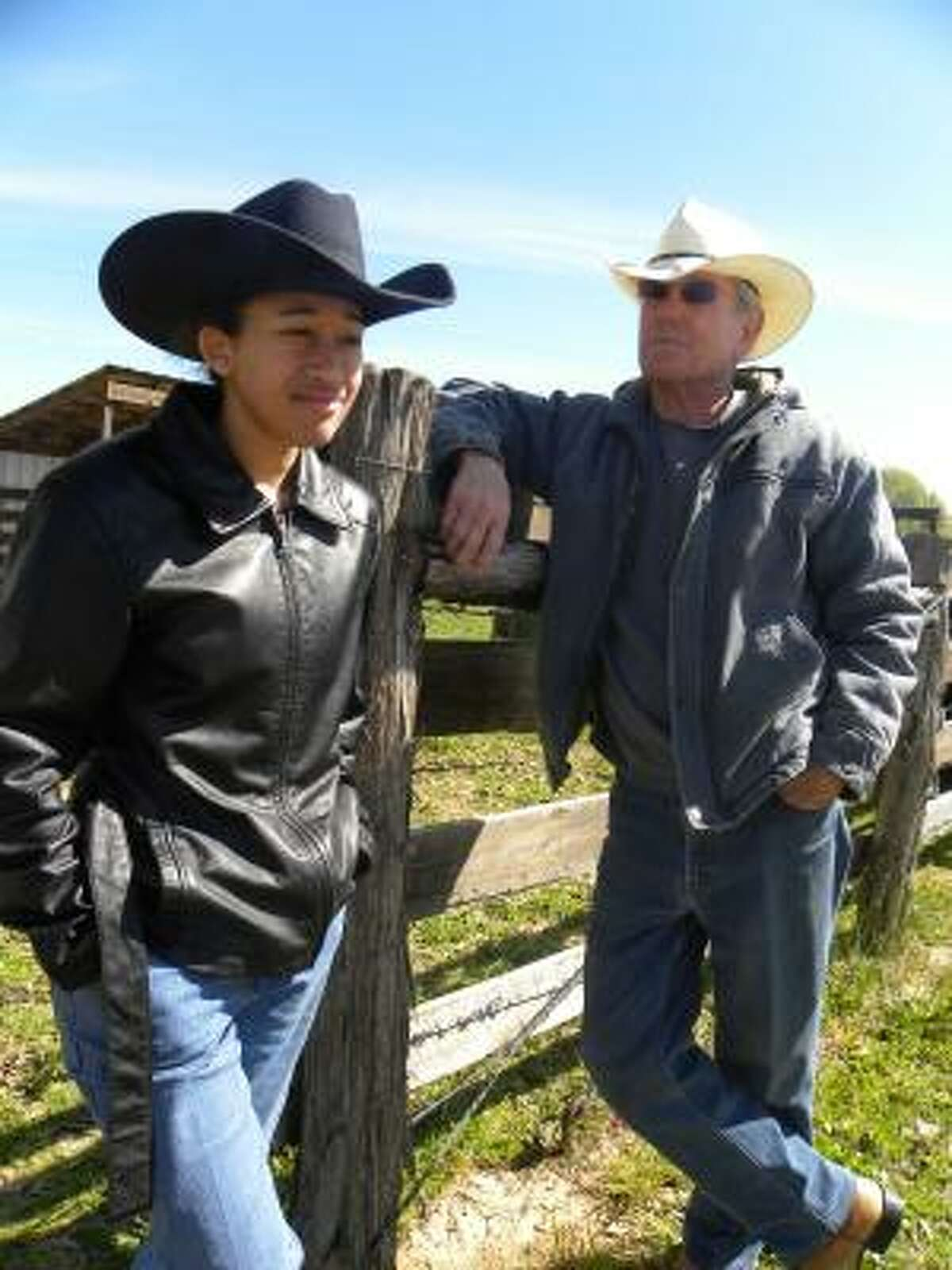 Domonique Goff and Louis Mogas talk cattle. Mogas recently purchased a cow and calf raised by Goff.