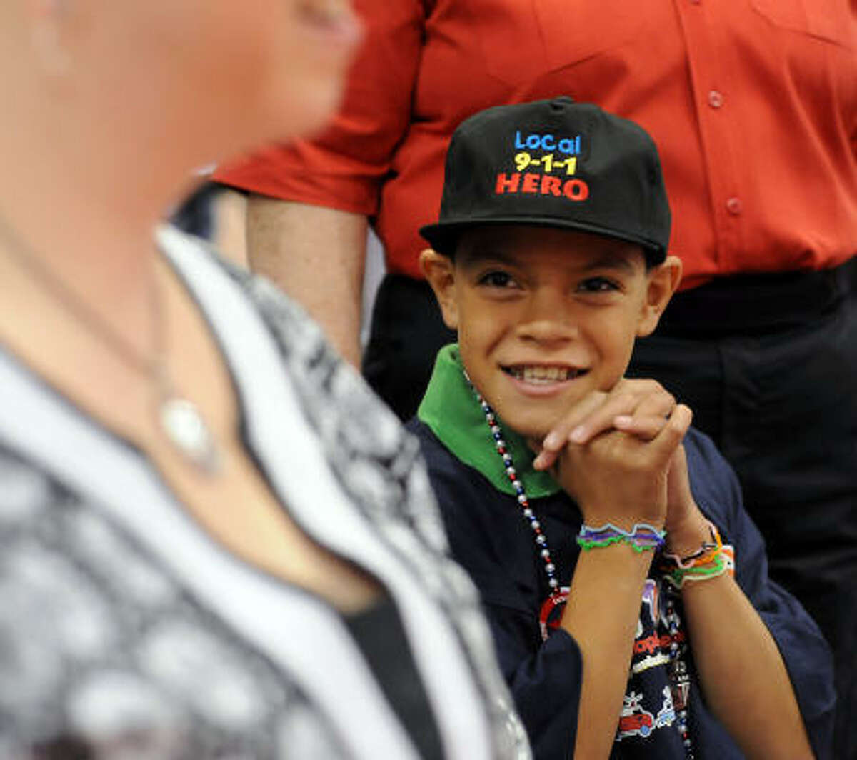 Julio Jimenez, age 8, waits to receive his award during at the local 911 Heroes Ceremony at the George R. Brown Convention Center on Tuesday. On April 16th while his little brother was choking, Jimenez called 911 and followed their instructions until the Cypress-Creek EMS arrived on the scene.