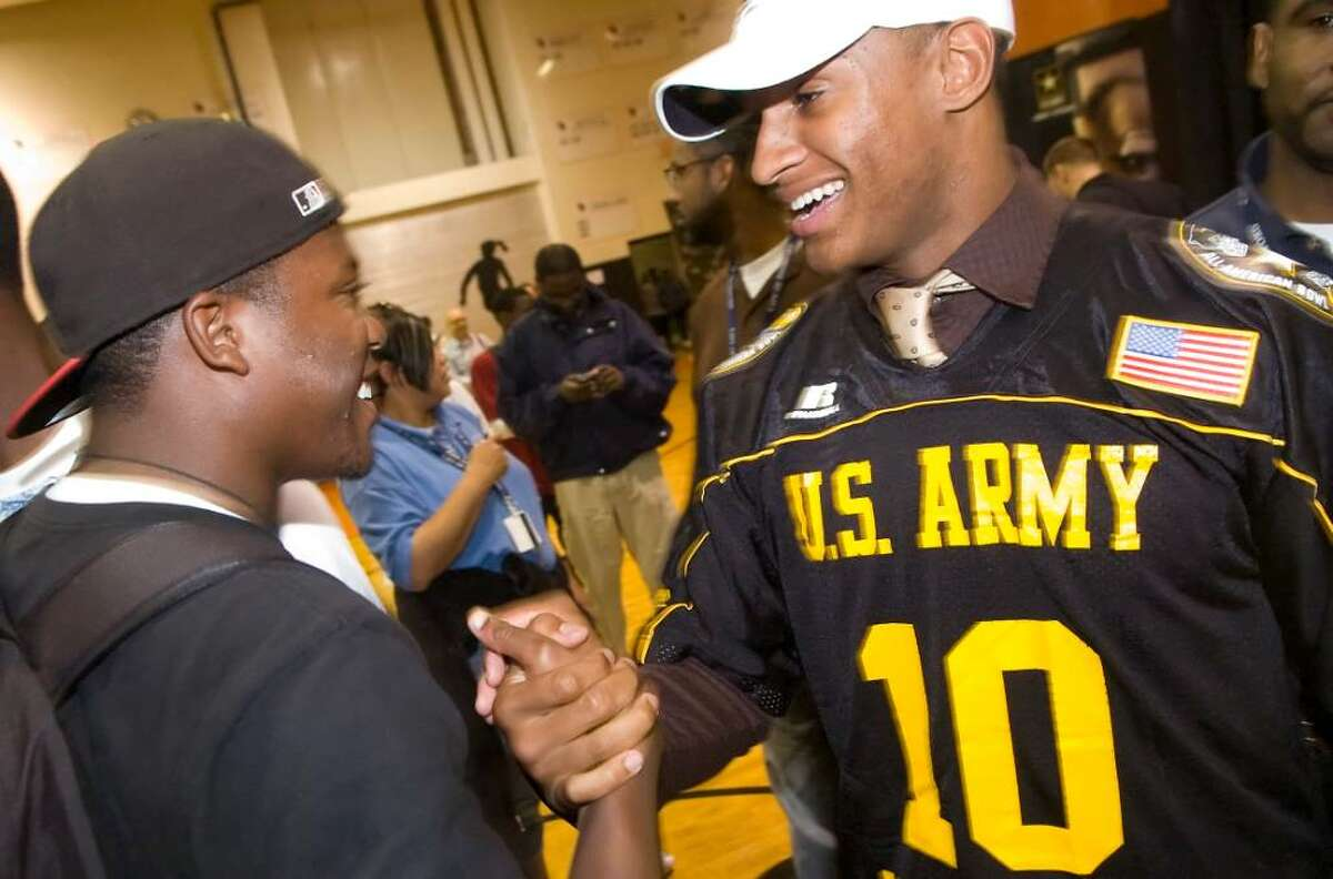 Khairi Fortt, of Stamford High School, greets a friend after announcing he will play football for Penn State next year during a rally and press event at Stamford High School in Stamford, Conn. on Monday, Oct. 5, 2009.