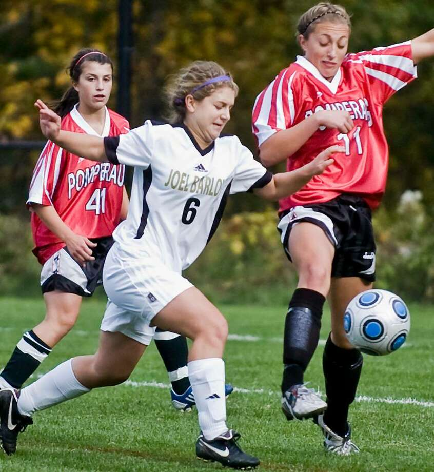 Barlow junior Delaney Bracken and Pomperaug senior Lauren Varholak try and get possession of the ball in a girls soccer game at Barlow. Monday, Oct. 5, 2009 Photo: Scott Mullin / The News-Times